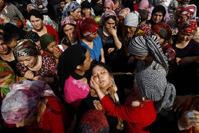 Muslim sisters console each other after discovering news of the death of their loved ones in the 2009 violence in Urumqi.