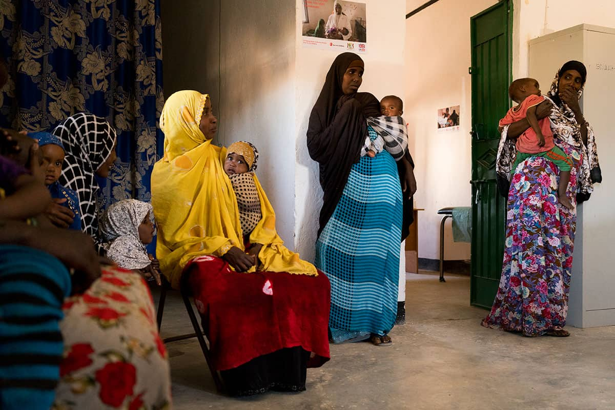 Women wait inside a healthcare centre in Yaka, Puntland [Source: Al-Jazeera]