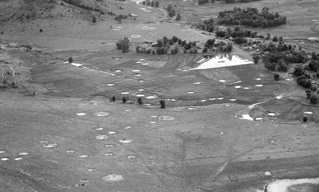 Aerial view of bomb craters in the landscape surrounding Phonsavanh, Laos